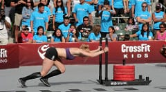 Picture of Annie Thorisdottir performing the sled push at CrossFit Games https://www.GetStrong.fit