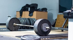 barbell weights loaded and resting on the ground https://www.GetStrong.fit/Fitness