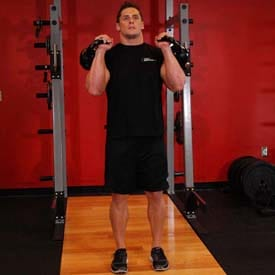 How to perform Kettlebell Split Jerk step 1 of 4 https://www.GetStrong.fit/Fitness
