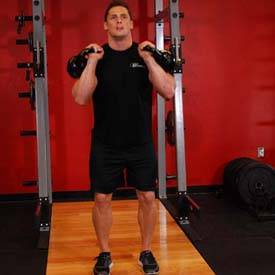 How to perform Kettlebell Split Jerk step 2 of 4 https://www.GetStrong.fit/Fitness
