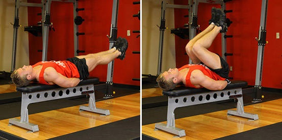 How to do the Flat Bench Leg Pull-In https://www.getstrong.fit/Flat-Bench-Leg-Pull-In-How-To-Exercise-Guide/Exercises