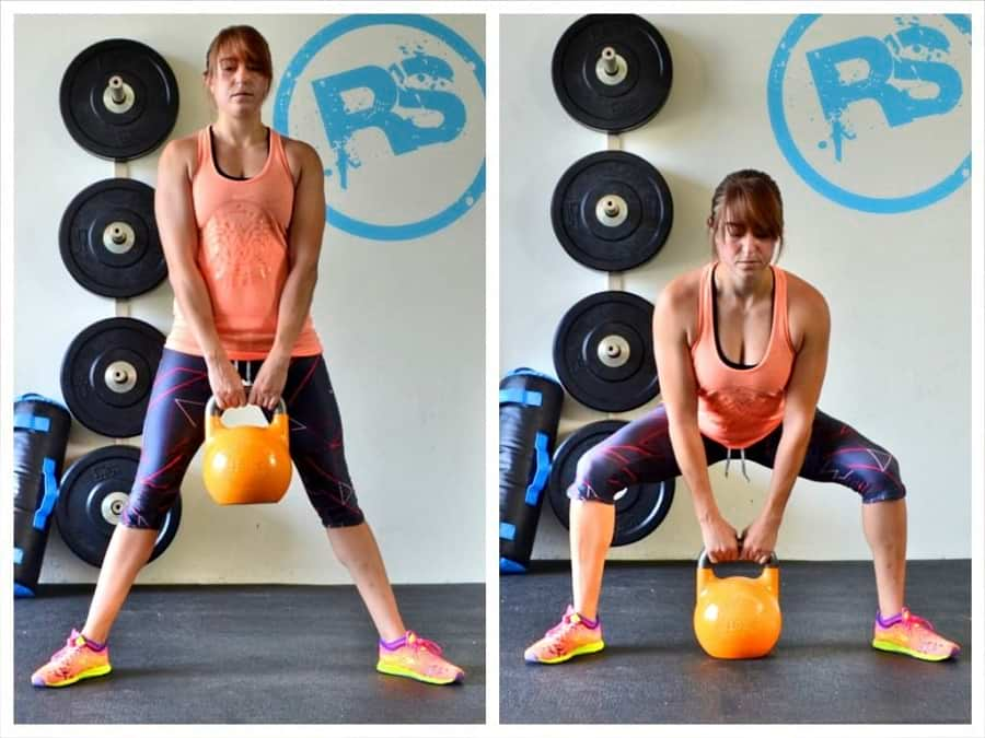 woman showing how to perform the Kettlebell Sumo Squat https://www.getstrong.fit/Kettlebell-Sumo-Deadlift-How-To-Exercise-Guide/Exercises
