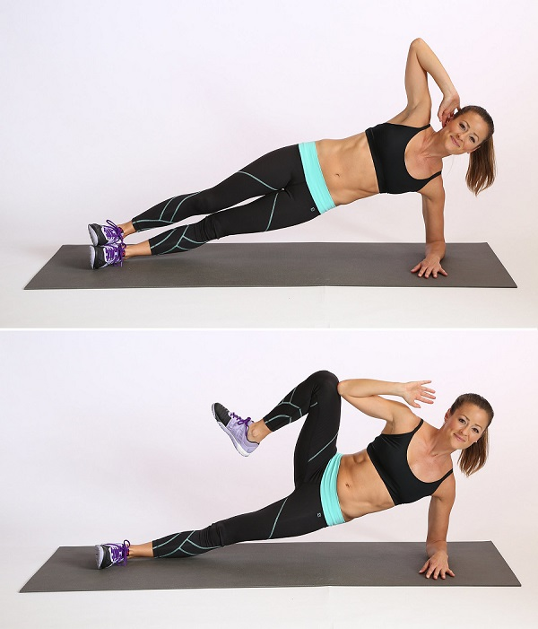 Woman showing how to do the Side Plank Crunch exercise https://www.getstrong.fit/Side-Plank-Crunches-Exercise-Guide/Exercises