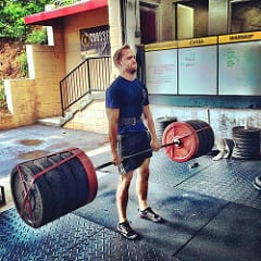 man performing 3 times body weight deadlift