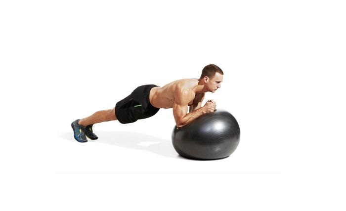 how to perform the swiss ball plank exercise https://www.getstrong.fit/Your-Swiss-Ball-Plank-How-To-Exercise-Guide/Exercises