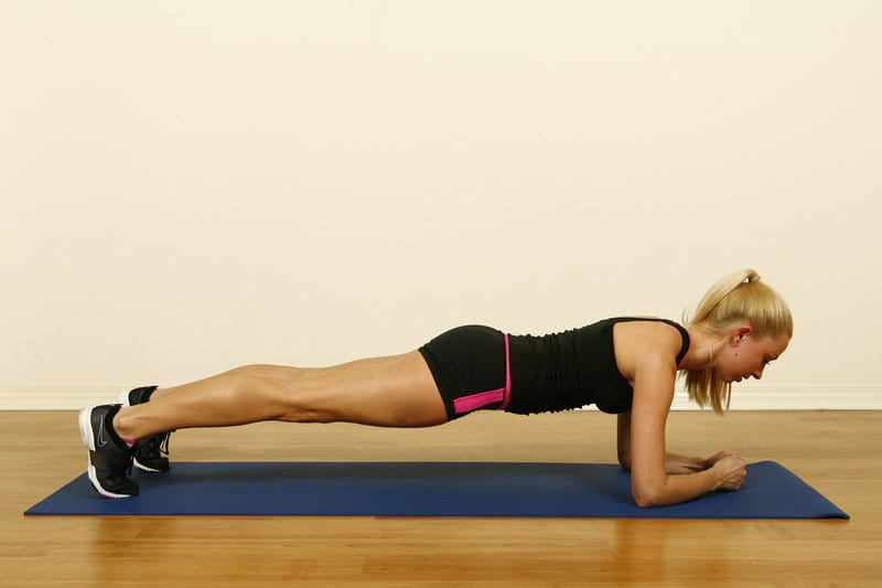 Woman performing the plank exercise