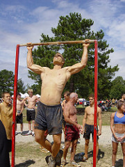 Man performing pull-ups in the park
