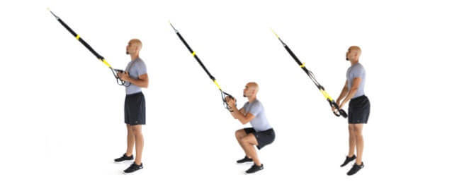 man showing how to perform the trx jump squat