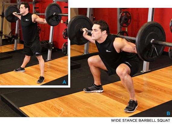 man showing how to perform the wide stance barbell squat https://www.getstrong.fit/Wide-Stance-Barbell-Squat-How-To-Exercise-Guide/Exercises